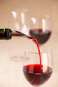 Red wine being poured using a drip-free pourer