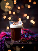 Black coffee with almond liqueur and whipped cream