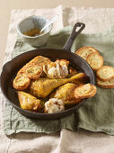 White wine and garlic chicken with garlic crostini