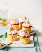 Muffins with meringue topping, nectarines and pistachios