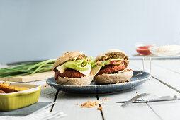 Vegan burgers with sweet potato fries