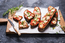 Baked toasted smoked flour bread with Ajvar (pepper paste) and vegan almond cheese