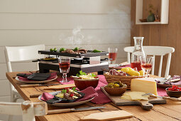Table laid with raclette