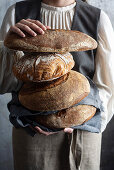 A woman holding Italian sourdough bread
