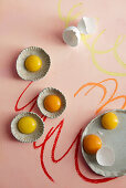 An arrangement of eggs with egg yolks in ceramic dishes