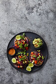 """Black bean, mushroom and rye """"meatball"""" tacos with blackened corn, avo and chipotle"""