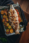 Whole baked rainbow trout with garlic and dill butter, lemongrass and crispy shallots