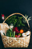 Basket of bread, vegetables, fruits and herbs