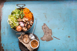 Ingredients for a miso dish with carrots, shiitake mushrooms and zoodles