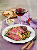 Steak stuffed with zucchini and sour cream dip