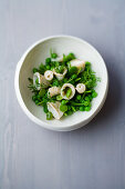 Pea salad with squid and anise