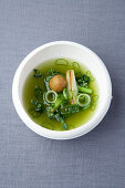 Spring onion and thyme tea with fried semolina dumplings