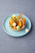 Apricot and pistachio tartlet with rocket