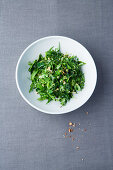 Herb and pine nut salad with dandelions and cinnamon oil