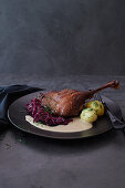 Goose leg with porcini sauce and red cabbage