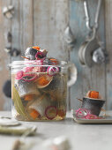 Homemade pickled herring with pumpkin and red onions