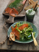 Marinated salmon with cucumber salad and a herb dip