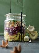 Layered salad with mushrooms, red cabbage and potatoes in a glass jar