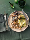 Fried herb mushrooms with black pudding and mashed potatoes