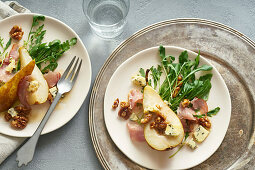 Pear salad with walnuts, prosciutto, arugula and blue cheese. Dinner appetizer