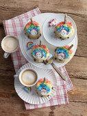 Rainbow cupcakes with unicorn decorations