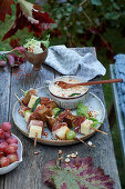 Obazda with grape, cheese and bacon skewers