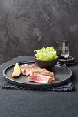 Tuna steaks in pepper marinade with lettuce