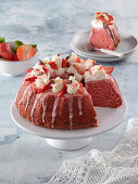 Strawberry cake with whipped cream and icing