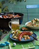 Grilled sausages and potato salad with a yoghurt dressing