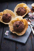 Vegan chocolate ice cream with chocolate chips in waffle shells