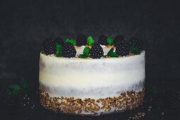 Blackberry cake with vanilla cream and hazelnut brittle