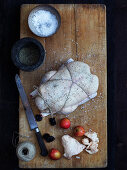 A tied-up duck with apple and plum stuffing