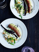 Cumberland sausage with a cabbage medley and a dip