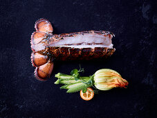 A butterfly-cut cooked lobster