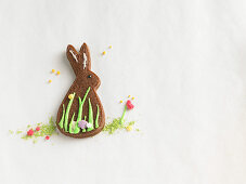 A brown Easter bunny biscuit on a sugar field
