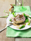 Lamb roulade with a creamy herb sauce and vegetables