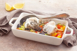 Monk fish on a bed oven-roasted vegetables