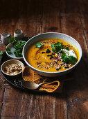 Spice-roasted pumpkin soup with macadamia dukkah