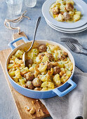 A cauliflower and potato bake with meatballs