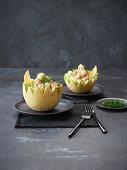 Melon halves with prawn salad