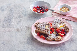 Chocolate waffles with summer berries and flaked almonds