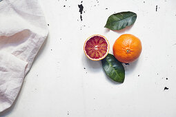 Blood orange, whole and halved