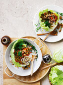 Vegetable-packed san choy bow with vermicelli noodles (tofu vs. pork)