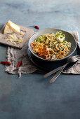 Whole grain spaghetti with hot zucchini and carrot spirelli