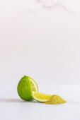 Lime with wedge and lime fruit powder