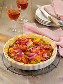 Colorful quiche with Hokkaido, bacon and red onions