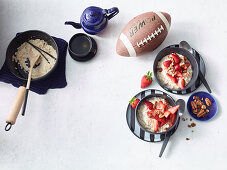 Porridge with oat milk, pecans and strawberries