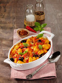 Fiery gnocchi with olives, capers, anchovies and chili