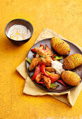 Chicken gyros with hasselback potatoes and a yoghurt dip
