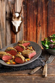 Saddle of venison with a pepper crust